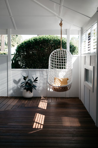 Deck with birdcage swing